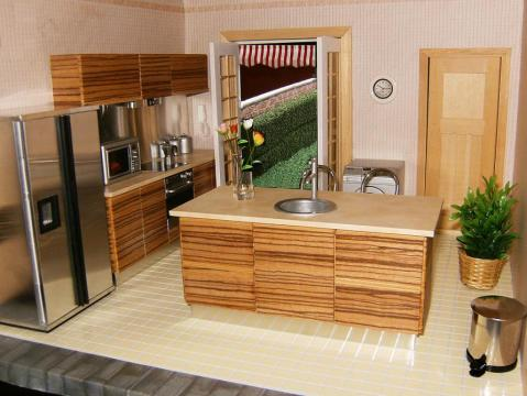 CDHM Artisan Elizabeth LePla of ELF Miniatures who designs and makes high quality modern 1:12 scale dolls house furniture specializing in fitted kitchens, bedrooms and bathrooms.