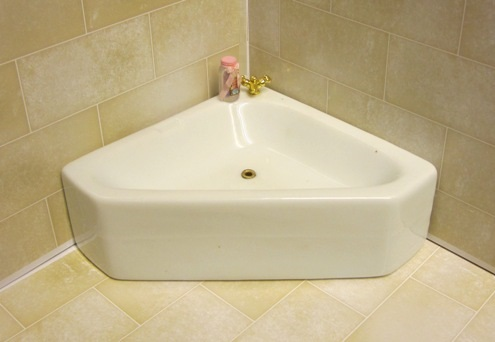 Corner china bath  - choice of tap