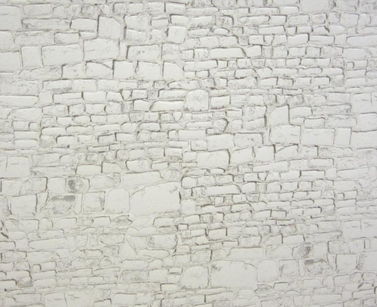Embossed white painted stone wall