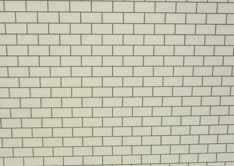 White metro tiling with dark grout