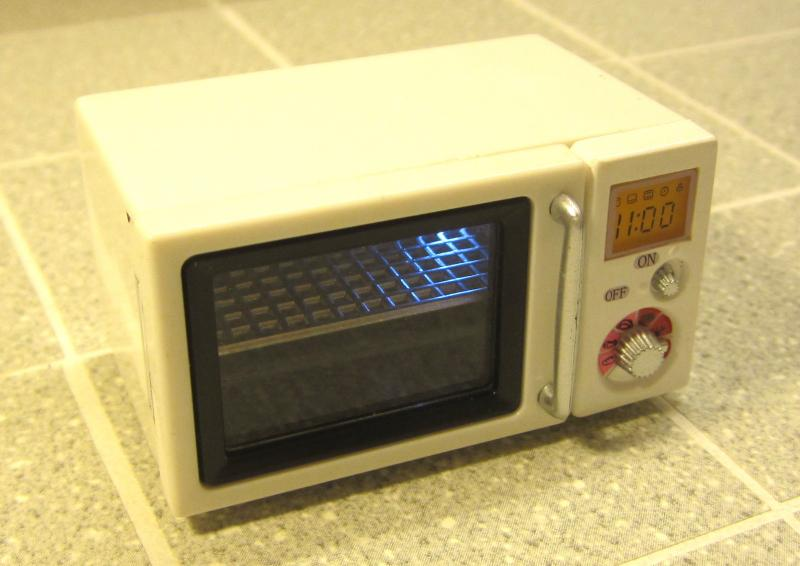 Opening white microwave with light